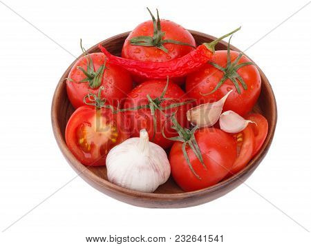Composition Of Tomato Bunch And Chili Pepper And Garlic On A Wooden Plate. Vegetarian Flat Lay. Toma