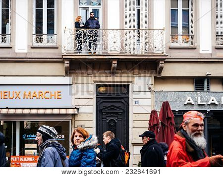 Strasbourg, France  - Mar 22, 2018: Couple From Balcony Looking At Demonstration Against Macron Fren