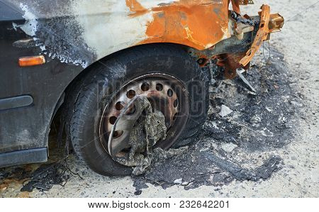 Burned Car Parked On The Street, Closeup