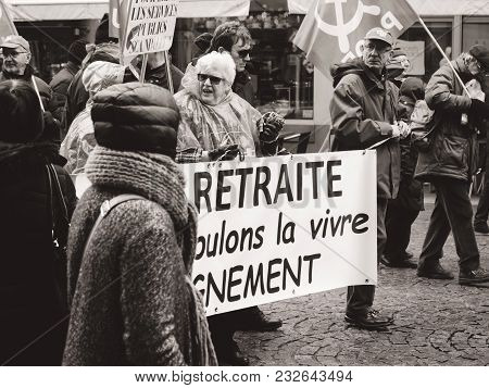 Strasbourg, France  - Mar 22, 2018: At Retirement We Want To Live With Dignity - Seniors With Banner