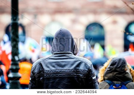 Strasbourg, France  - Mar 22, 2018: Rear View Of Surveillance Young Man Wearing Hoodie Coat At Demon