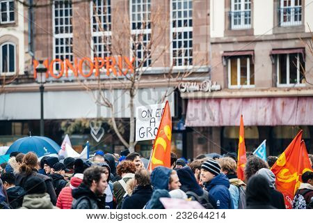 Strasbourg, France  - Mar 22, 2018: Crowd With Flags In Place Kleber At Demonstration Protest Agains