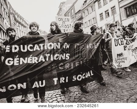 Strasbourg, France  - Mar 22, 2018: Young Group With Banner Education In Danger At Demonstration Pro