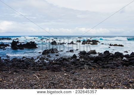 Huge Waves Crash Over Lava Rocks On The Windward Shore Of The Big Island In Hawaii.