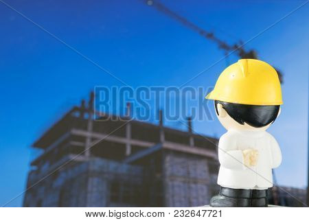 The Cartoon Engineer Stands Looking At The Building Being Built On The Screen.
