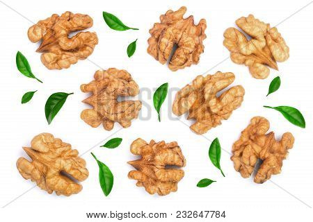 Walnut Kernels Decorated With Leaves Isolated On White Background. Top View. Flat Lay.