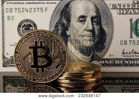 Golden bitcoins and dollar banknote. Concept of trading cryptocurrency. Business concept. Exchange bitcoin.