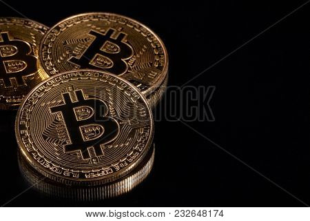 Golden bitcoins on black background. Concept of trading cryptocurrency. Business concept.