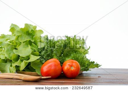 Set Of Salad Which Are Tomato, Frilly Iceberg And Green Oak On Wooden Tray With Spoon And Fork