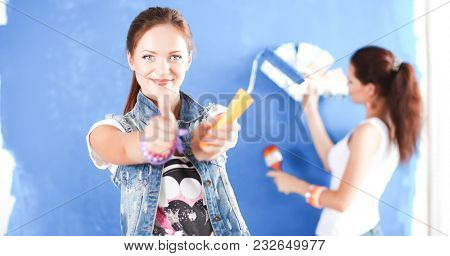 Two Young beautiful women holding color palette