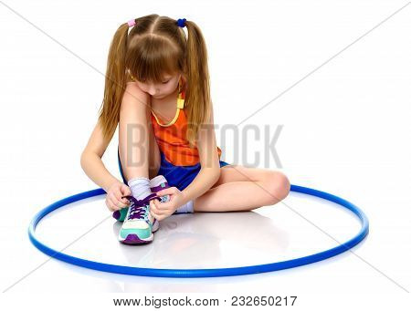 The Little Girl Puts On Her Shoes. The Concept Of Beauty And Fashion, Happy Childhood. Isolated On W