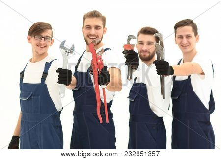 group of construction workers with working tools