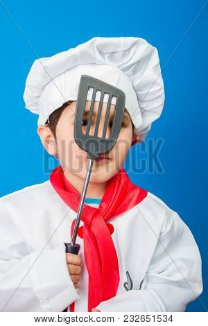 Pizza, The little boy in a suit of the cook. adorable little boy in chef hat and apron smiling at camera in kitchen. boy in chef's hat
