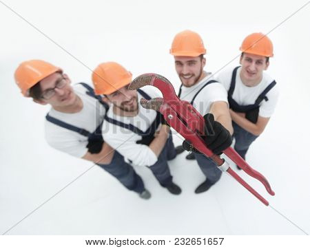 view from the top.the team of plumbers showing gas keys
