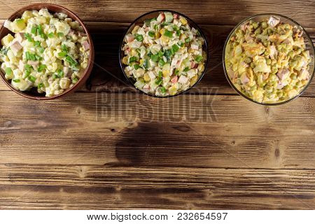Set Of Festive Mayonnaise Salads On Wooden Table. Top View