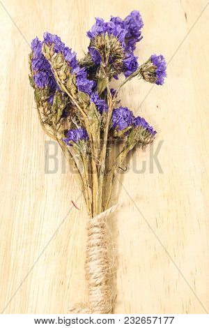 Macro Of Single Of Violet Statice Flower Background Use For Decoration On Small Brown Rope Sack