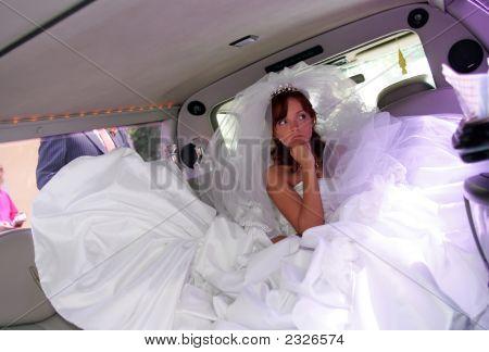 Unhappy Bride In Wedding Car Limousine