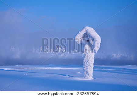 The Frozen And Become Covered With Hoarfrost Post In A Strong Frost, Russia, Siberia.