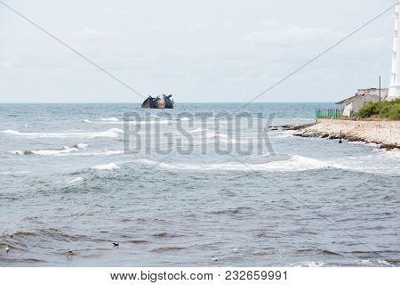 Landscape Of Shoreline And Piece Of Sunken Ship On Background.