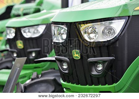 Kaunas, Lithuania - March 23: John Deere Tractors And Logo On March 23, 2018 In Kaunas, Lithuania. J