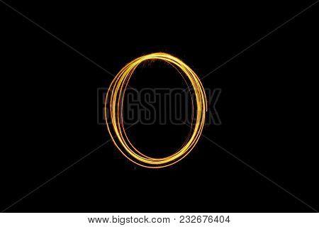 Orange Light Painting Zero Number On Black Background .