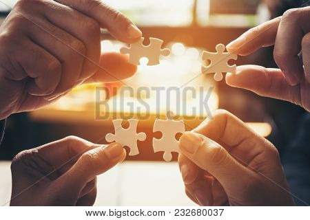 Team Hand Power Full  Hand Placing The  Jigsaw Puzzle Piece For Conect Business Partner And Connecti