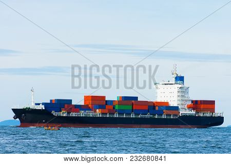 Cargo Container Ship Carrying Container Import And Export  Goods Running Around Container Yard Port