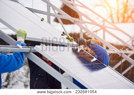 Team Of Electrician Workers Installing Solar Panels On Power Station Photovoltaic Energy Electricity