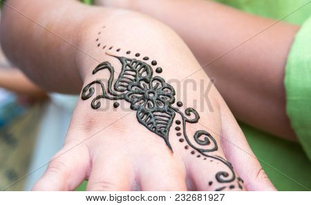 Henna Tattoo On A Hand, Floral Motif Drawing. Henna Being Applied To Hand, Freshly Applied, Still Fr