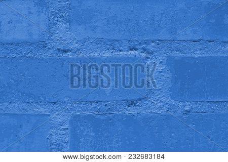 Stone Wall Of The Rectangular Bricks - Close Up. Toning In Pantone Color Marina.