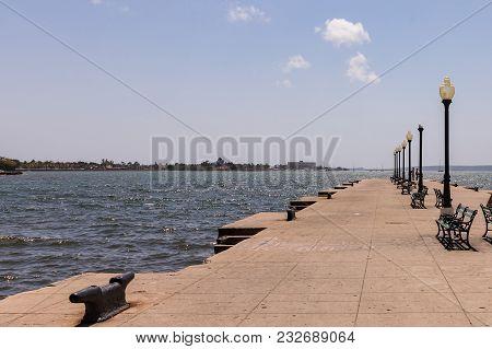 Muelle Real Pier In Cienfuegos, Cuba. Benches On The Pier In Port Cienfuegos.