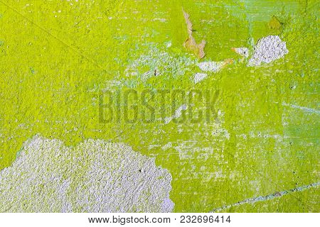 Green Repair Wall Background With Scratch And Piece Of Paper. Rough Housework Wallpaper Design Backd