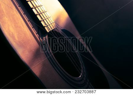 Acoustic Guitar In The Light Of The Sun With Vintage Light.