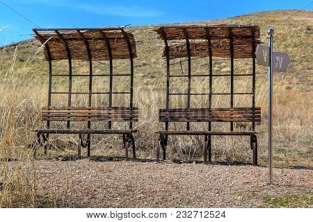 Abandoned Bus Stops And Dilapidated Places For Recreation In The Wild Steppe. Deterioration Of The E