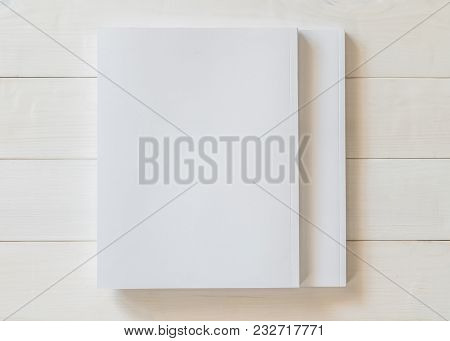 Mock-up book cover blank A4 size paperback mockup for catalog, magazine booklet, portfolio, menu design template with page front side on white surface on wood table poster