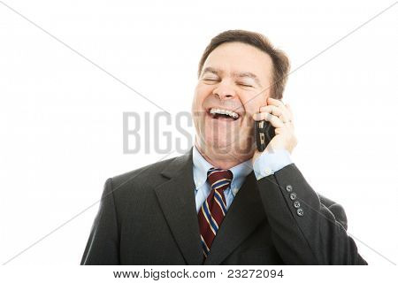 Fortyish businessman laughing as he talks on his cellphone.  Isolated on white.