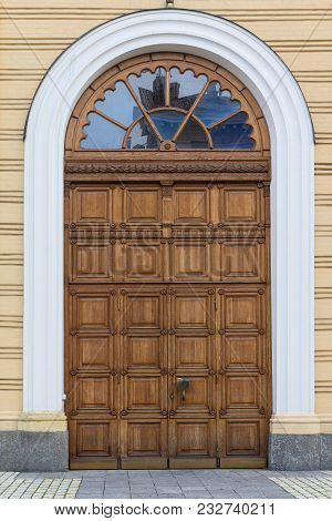 Wooden Arched Door In The Classical Style. The Architecture