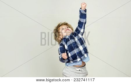 Success Win. Boy Is Growing, Child Is Stretching And Shows Fist Up. Gestures And Poses, Child Is Rap