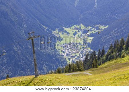 Chairlift With View Into The Valley, Montafon, Austria. Backlit Photograph