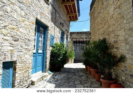 Narrow Greek Cyprus Street - White Houses With Blue Door, Troodos Mountains Cyprus