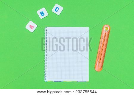 Letter Blocks Alphabet Abc With Notebook And Ruler On Green Background. Concept Abc Practice For Kid