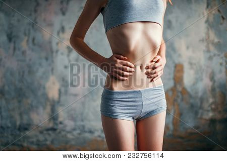 Female with slim waist, weight loss, anorexia