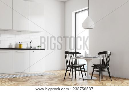 White Dining Room And Kitchen Corner With A Wooden Floor, A Round Table And Black Chairs. 3d Renderi