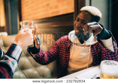 Young Afro American Man Is Holding Car Keys And Refusing To Drink Beer From His Friend In Pub. Do No