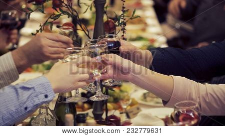 Hands Holding Glasses And Toasting, Happy Festive Moment, Luxury Celebration Concept. Clink Of Glass