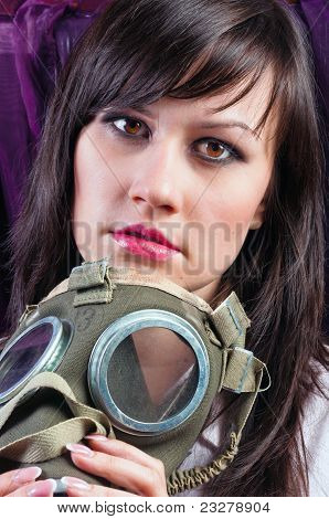 Portrait Of A Young Woman Holding Her Gasmask Tight