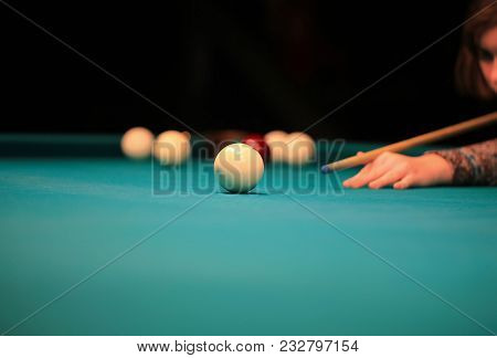 Playing Billiard. Billiards Balls And Cue On Green Billiards Table. Billiard Sport Concept. Pool Bil