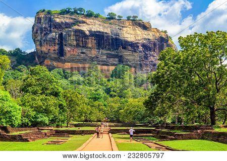 Sigiriya, Sri Lanka - January 4, 2018. Fortress Of Sigiriya Lyon Rock Among The Rain Forest Against
