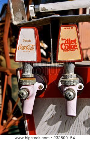 Jerome, Arizona, January 30, 2018: The Faded Coke Spigots Are Products Of Coca Cola, Headquartered I