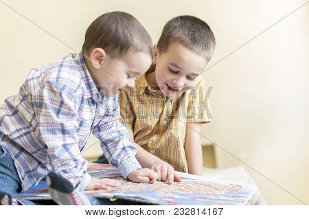 Two Little Brothers Read A Children's Book. Children's Friendship, Fun Education